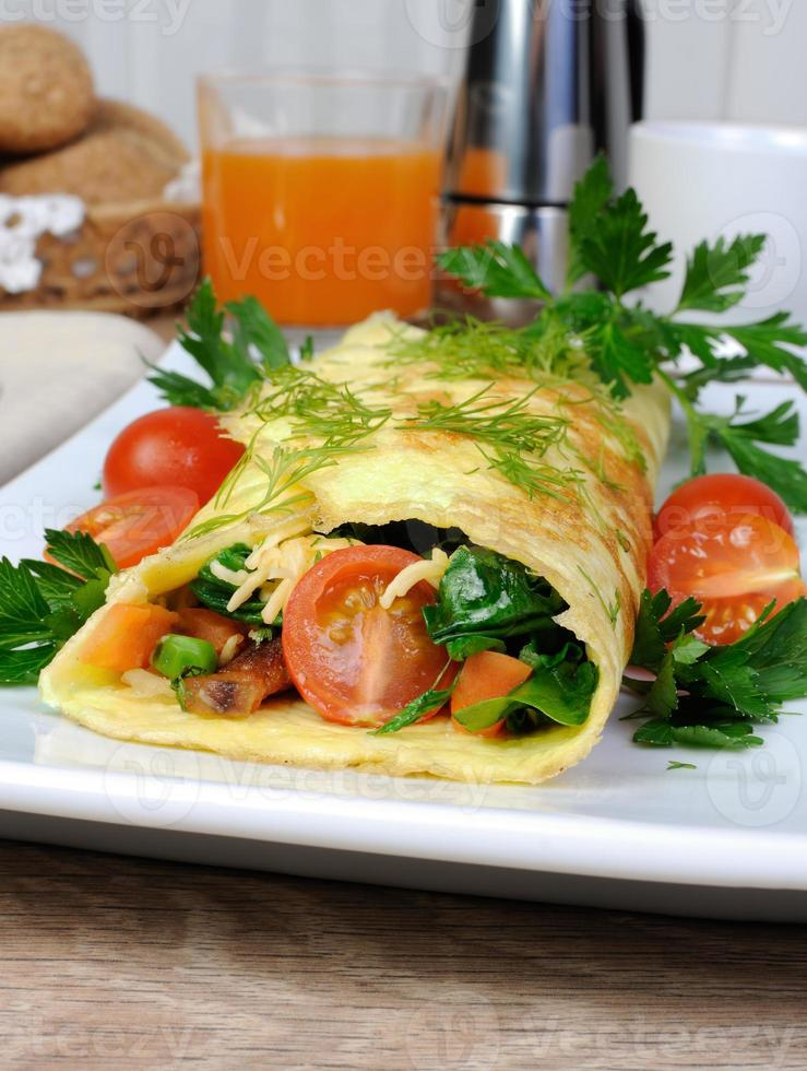 Omelet stuffed with vegetables photo