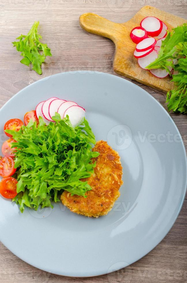 Breaded pork chops in Parmesan cheese photo