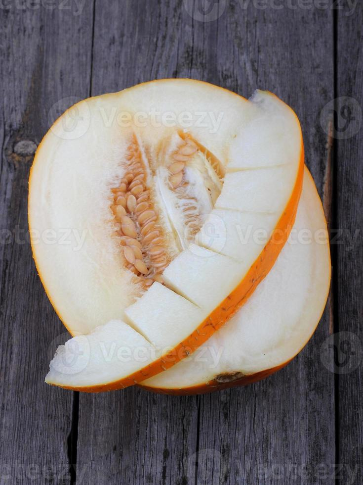 Sliced melon on wood background photo