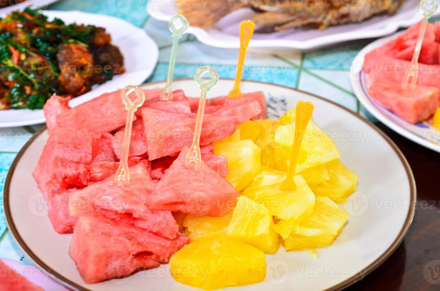 pineapple, watermelon on dish photo