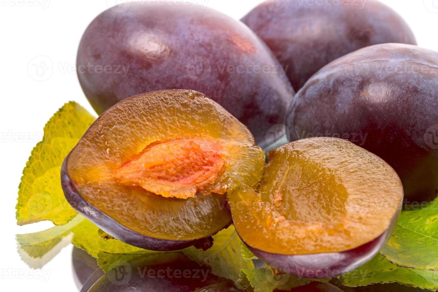 Ripe plums on white photo