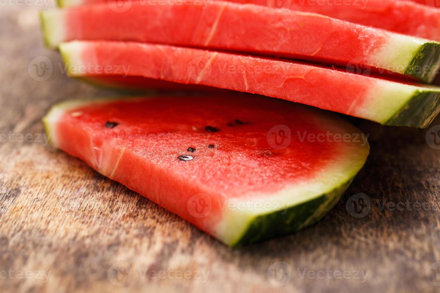 Delicious, juicy watermelon on the table photo