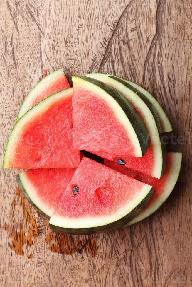 fresh watermelon on wooden background photo