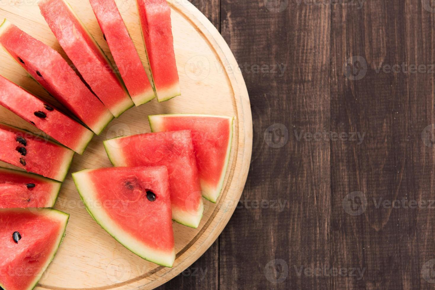Healthy slice watermelon on a wood background photo