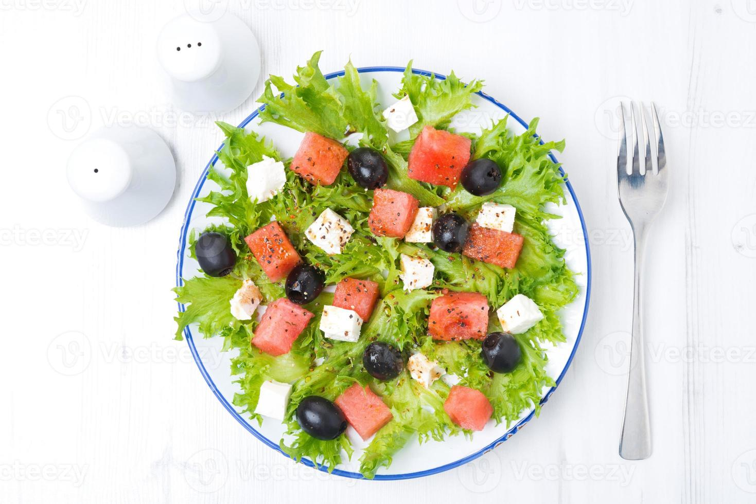 fresh salad with watermelon, feta cheese and olives, horizontal photo