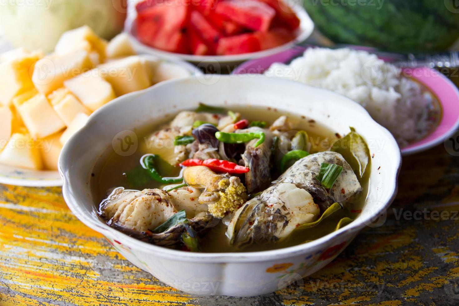 Soup fish and fruits photo