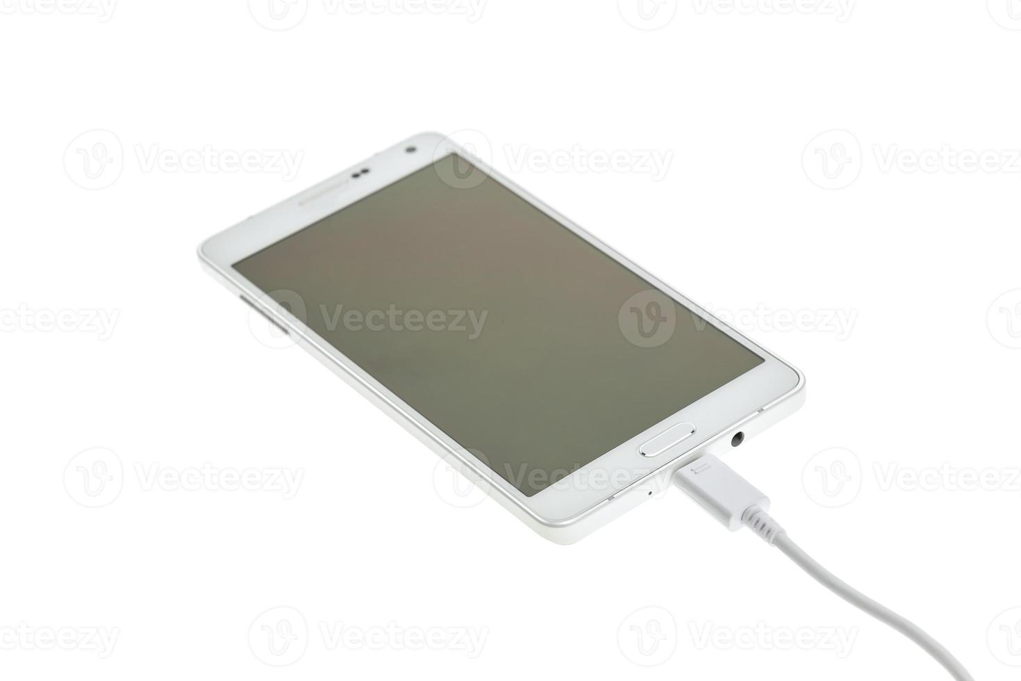 Smartphone connect with charger photo