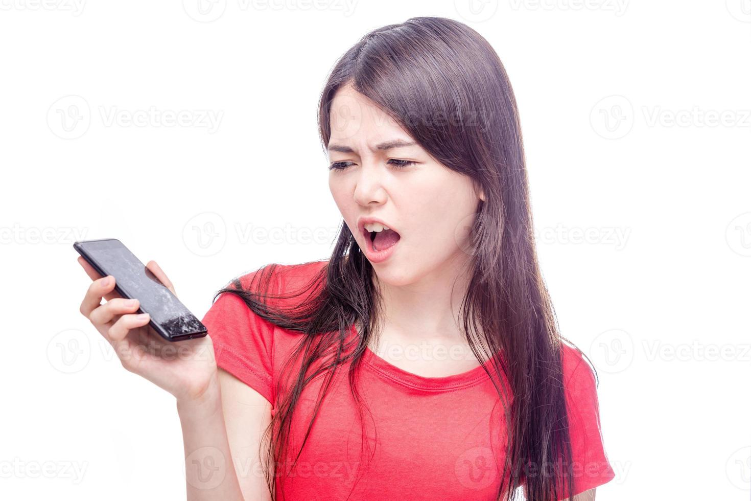 Chinese woman frowning at broken cell phone photo