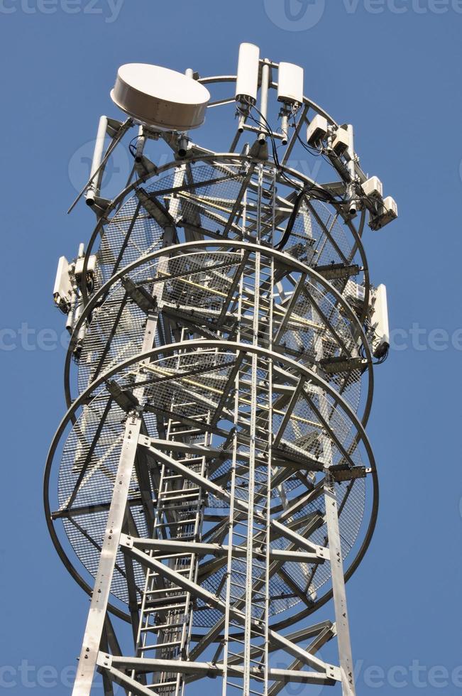 Telecommunication tower with antennas photo