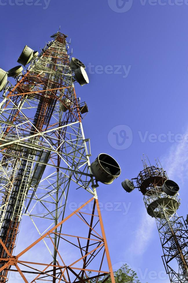 telecommunication towers with blue sky photo