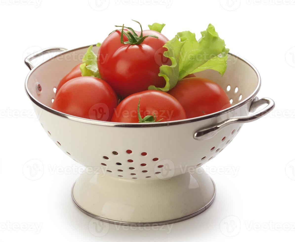 tomates en el colador foto