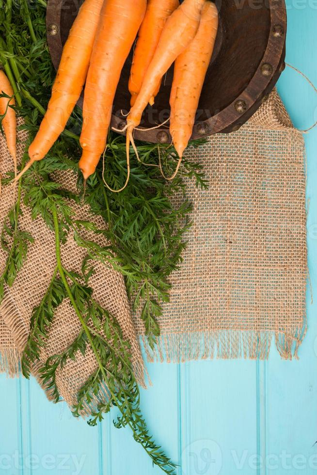 Carrots on a wooden table photo