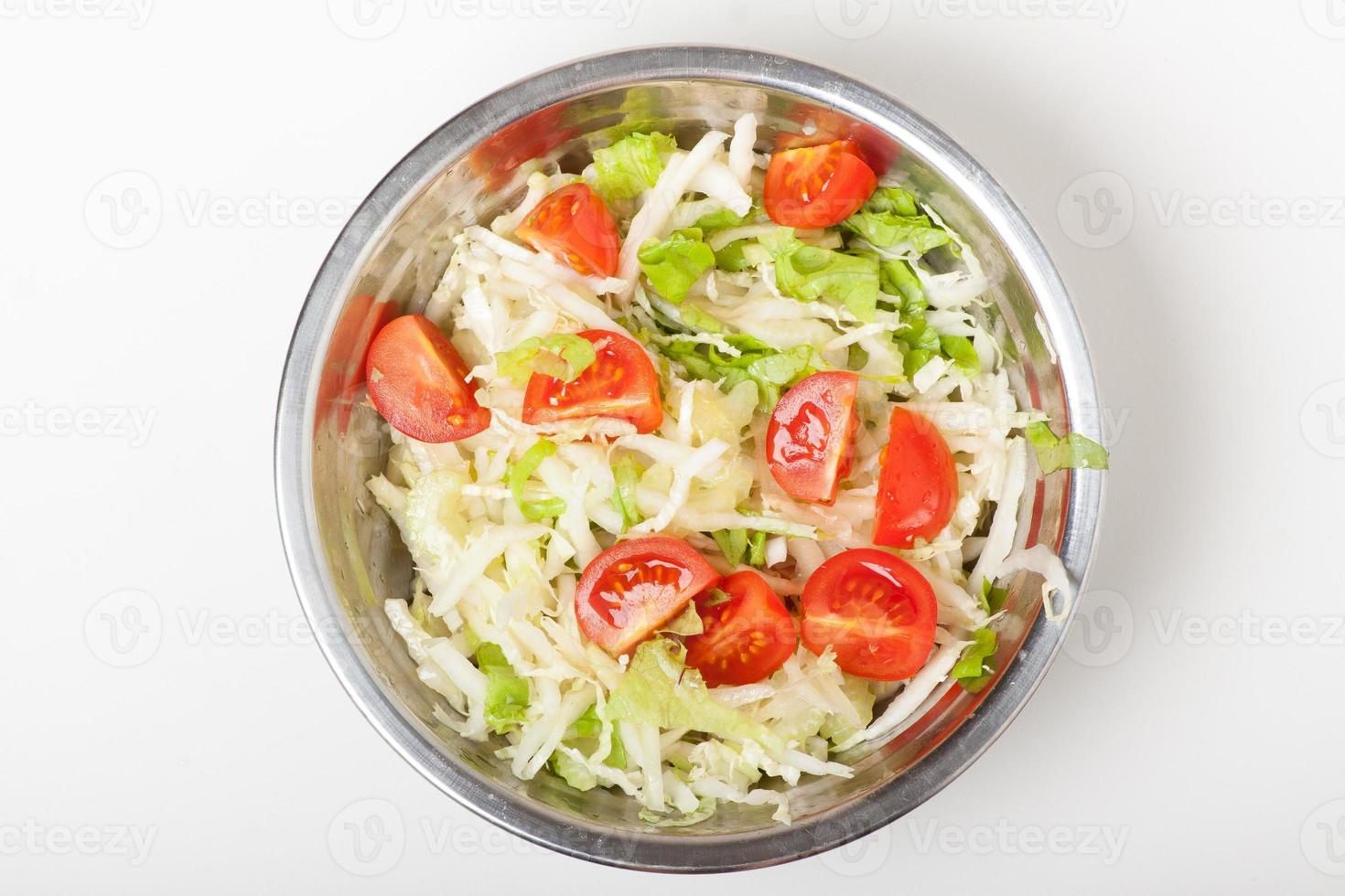 fresh salad in a metal plate on white photo