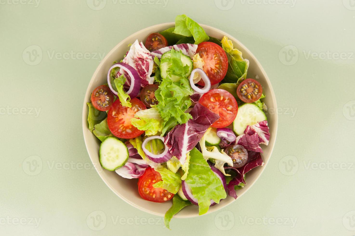 Fresh vegetable salad in a bowl photo