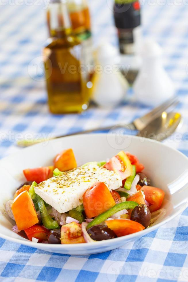 Greek salad with feta cheese, peppers and olives photo