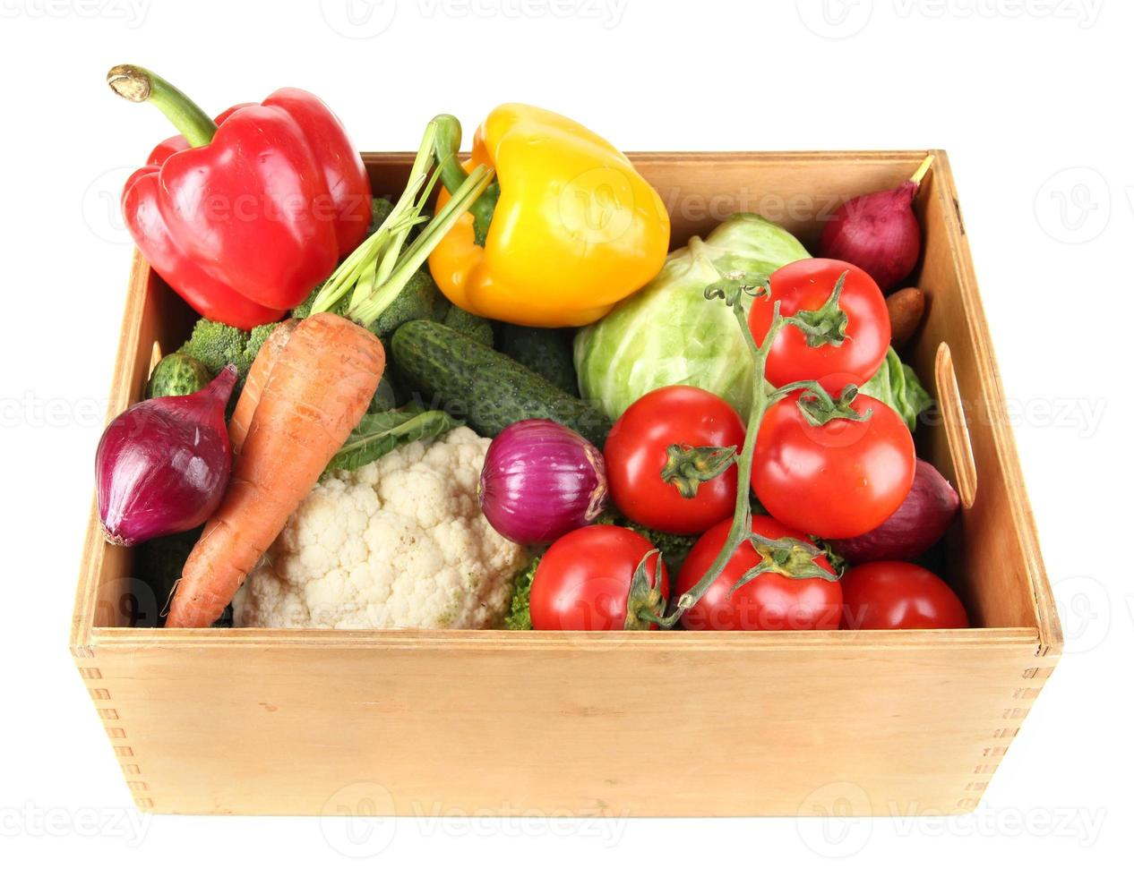 Fresh vegetables in wooden box on white background photo