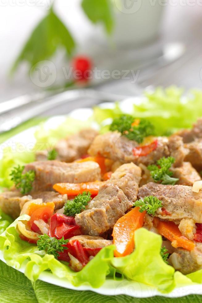 Warm salad with meat and fried vegetables photo