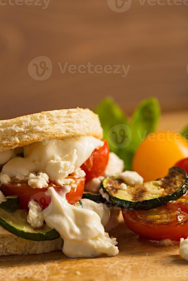 Vegetarian Burger with fried tomato and feta cheese photo