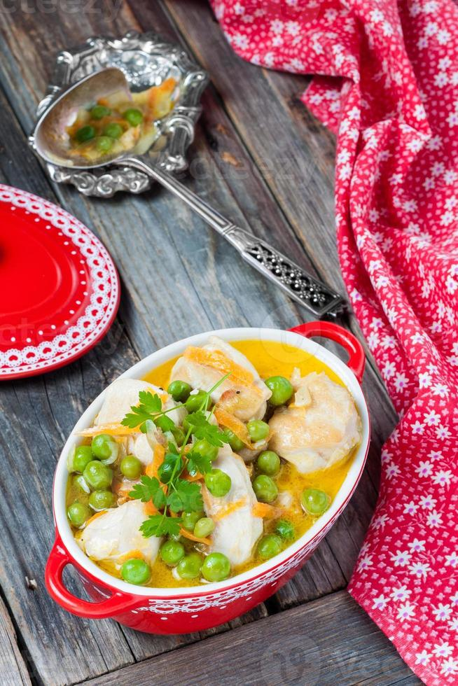 Chicken stew with peas in cream sauce photo