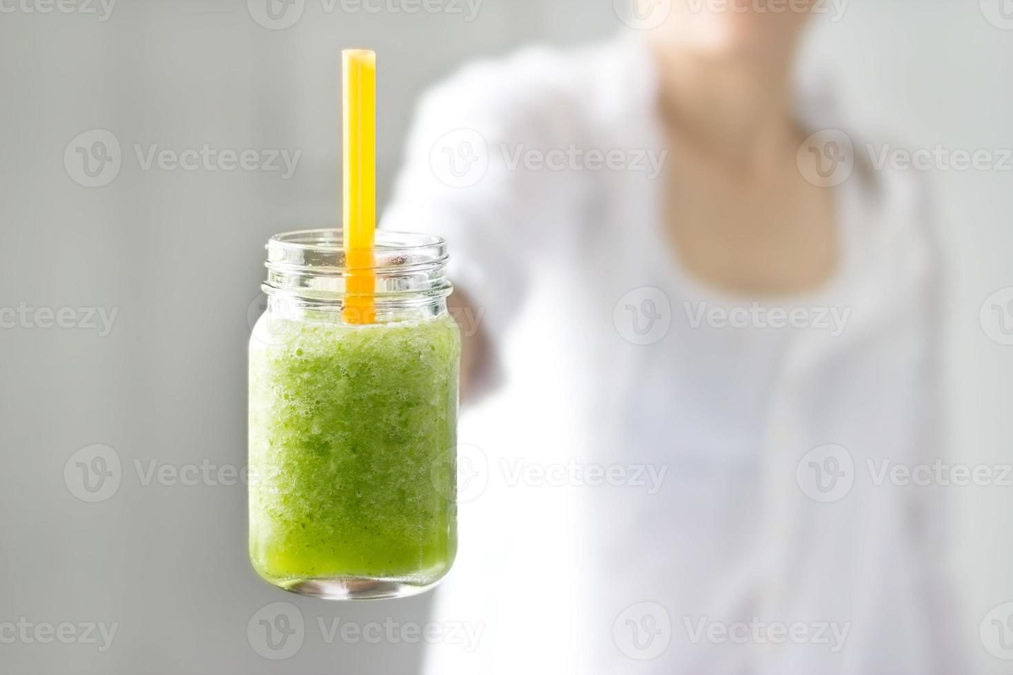 Fresh smoothie detox vegetable lettuce and cucumber in hand photo