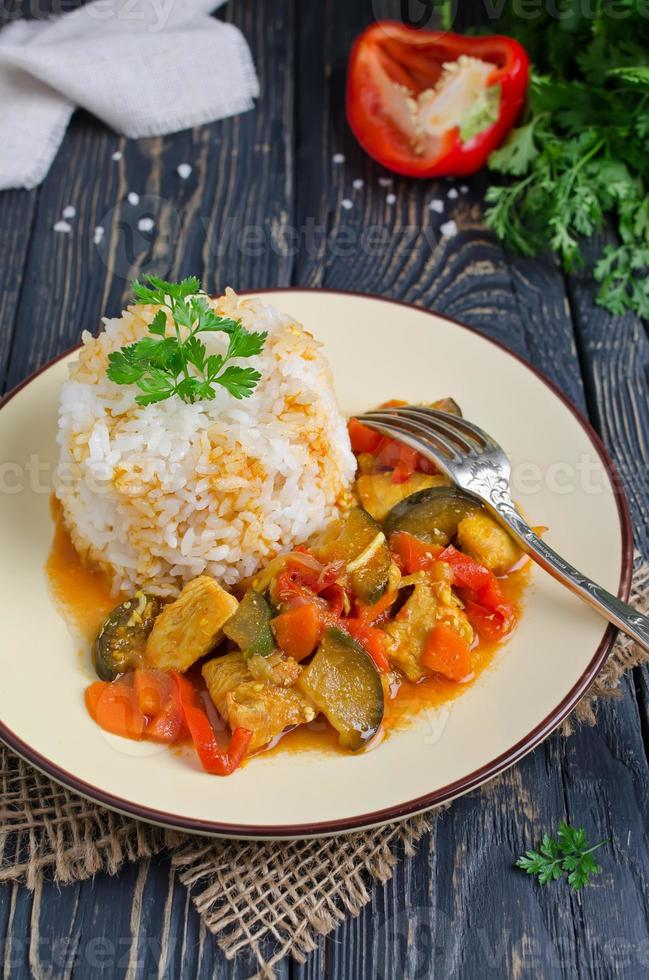 Rice and stew with chicken and vegetables photo