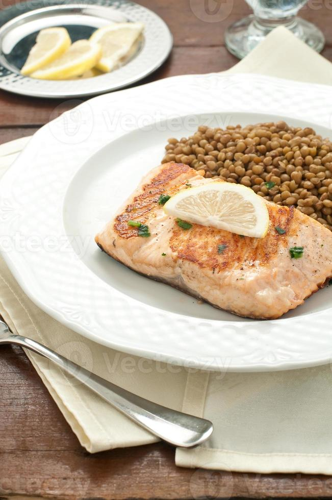 Fillet of grilled salmon with lentils photo