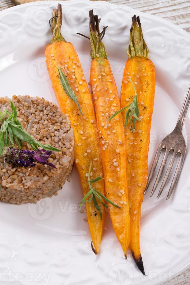 Wheat groats  and Caramelized carrots photo