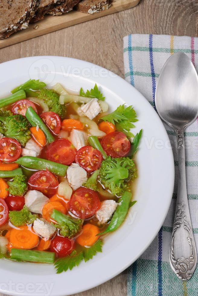 Vegetable soup with chicken photo