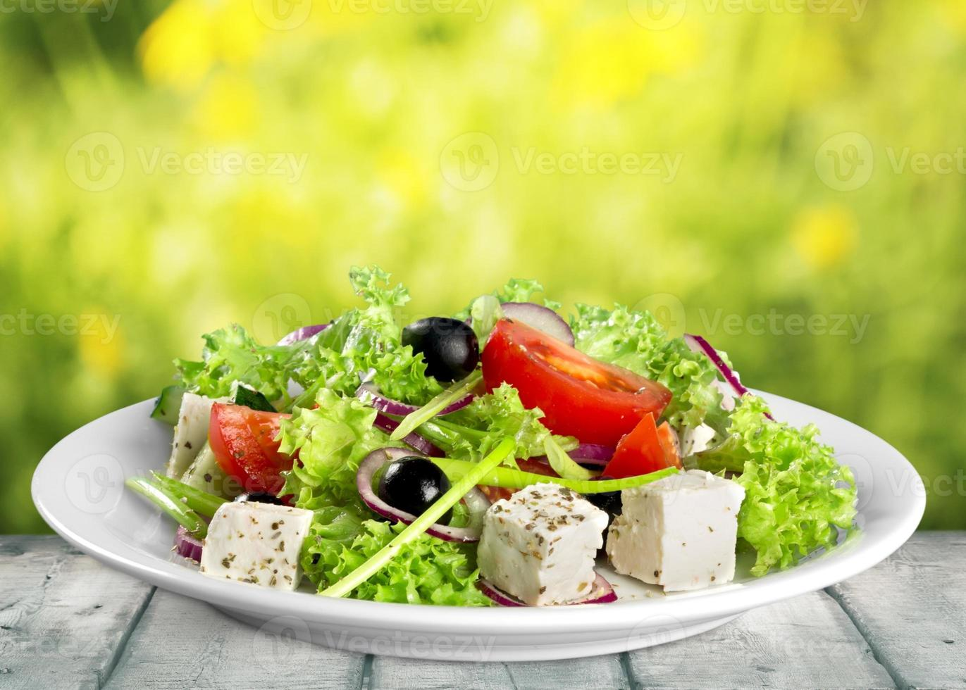 Closeup view of a plate of fresh healthy Greek salad photo