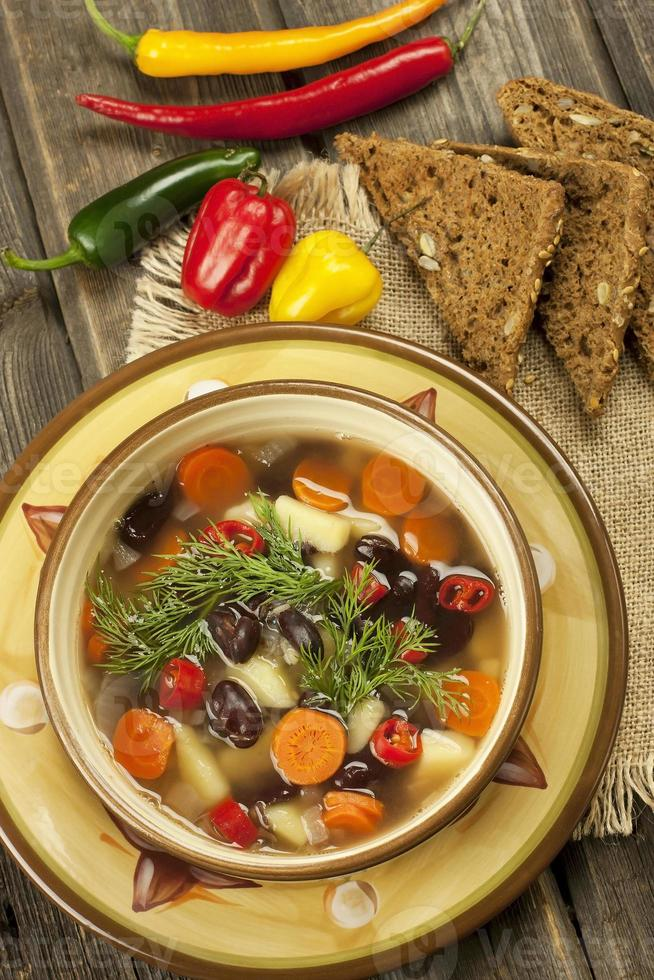 Traditional bean soup in the bowl photo