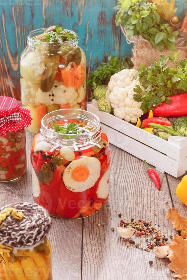 Assorted mixed vegetables in preserving jars photo