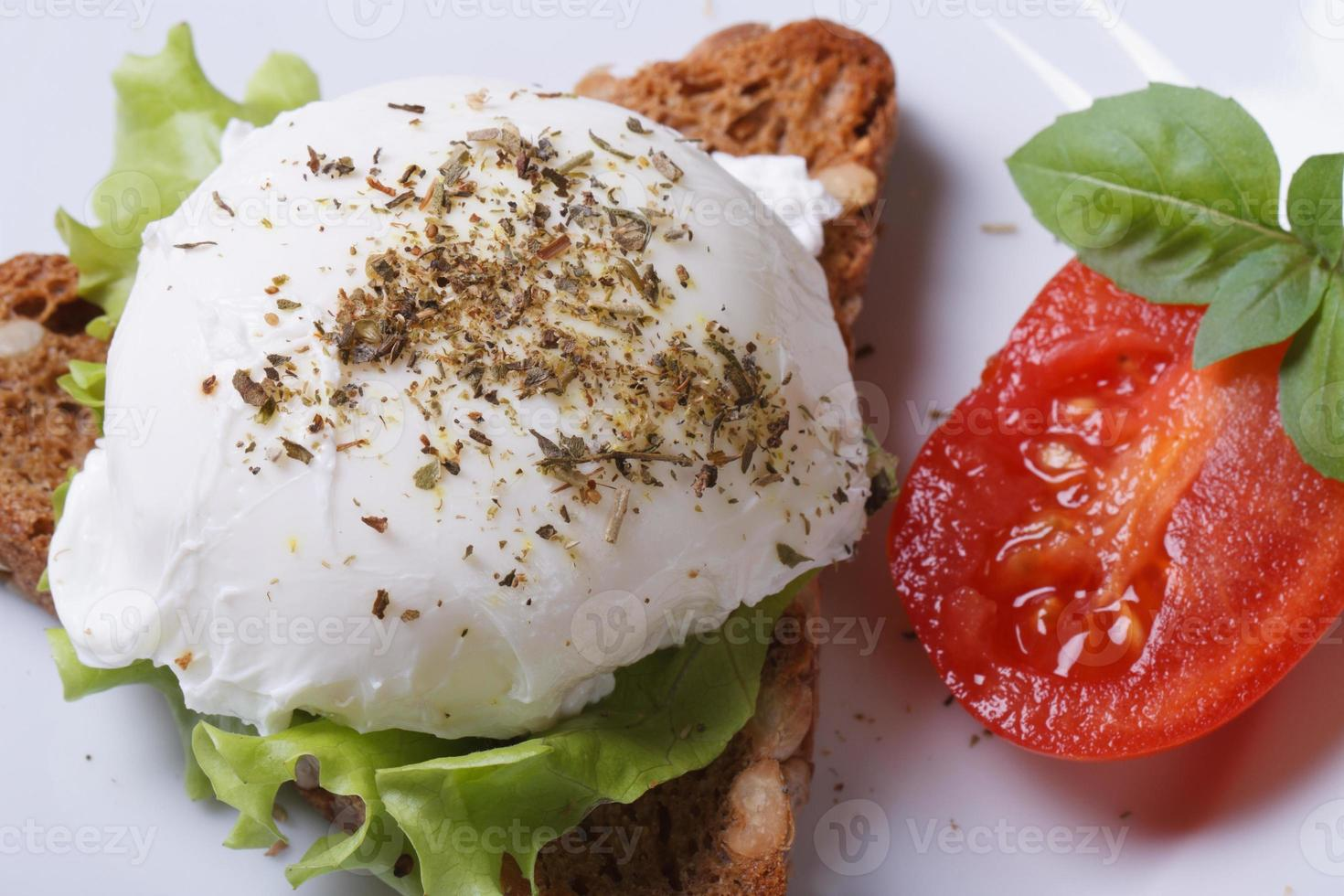 sandwich with poached egg top view. close-up photo
