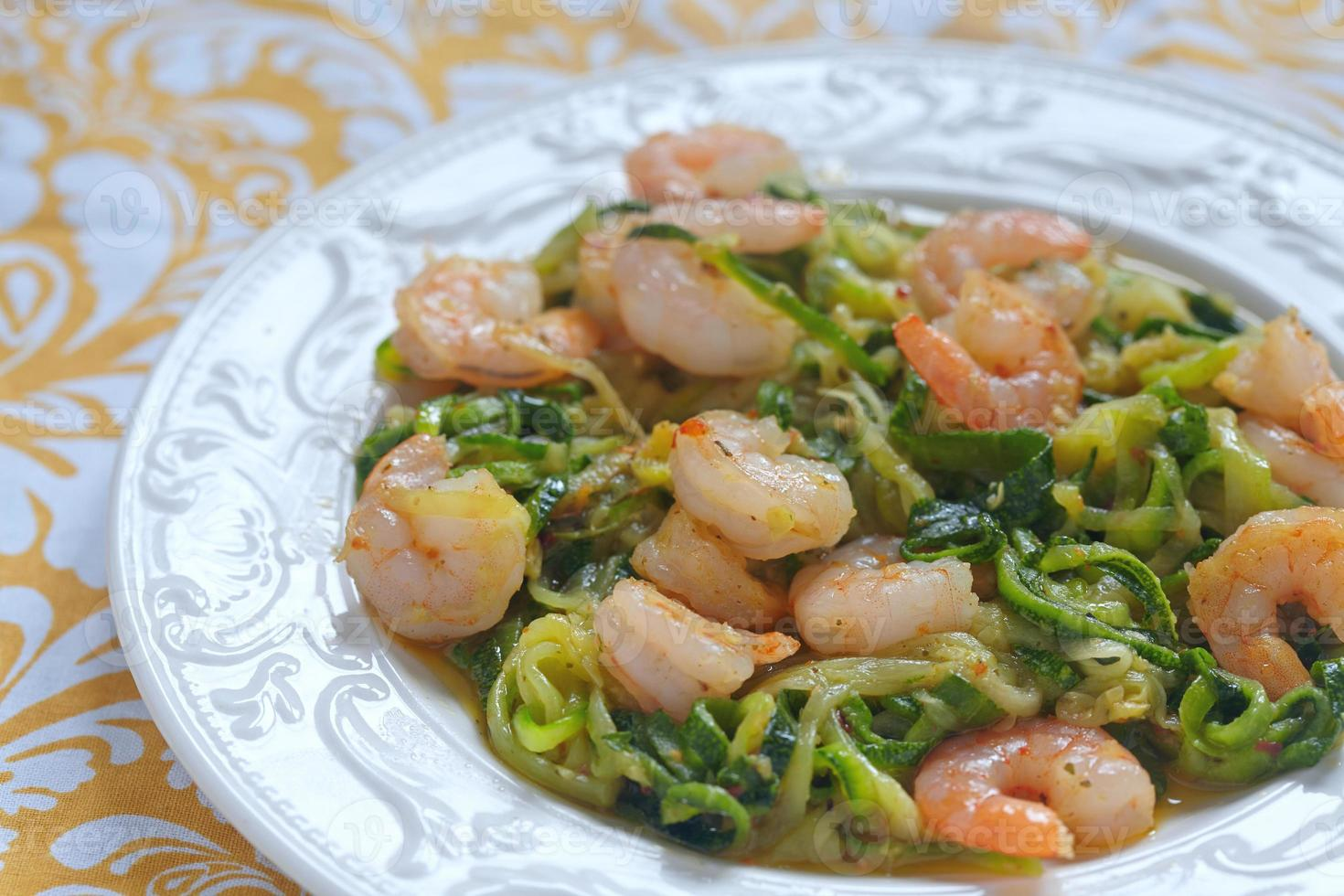 Zucchini pasta with a shrimps photo