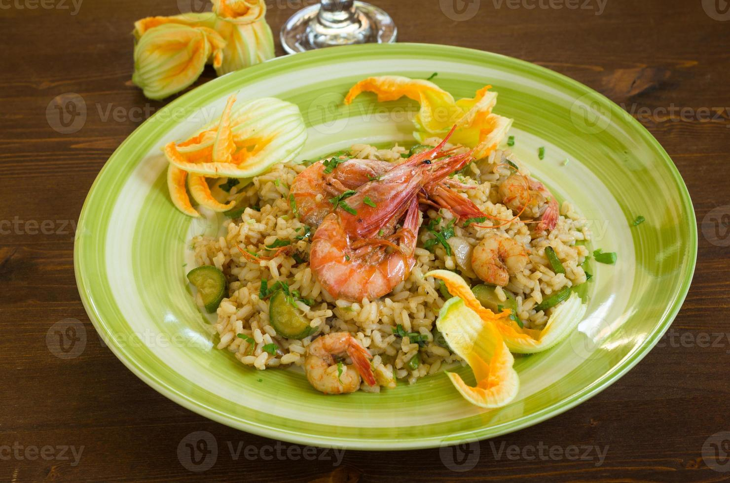 Risotto with shrimps and zucchini photo