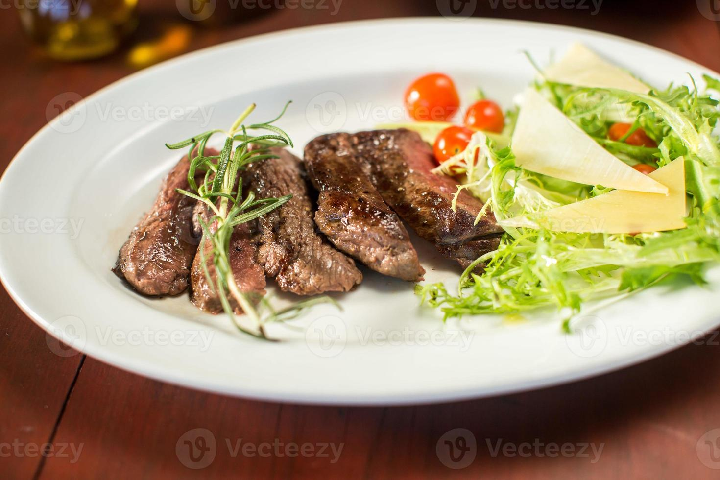 Steak with cheese and vegetables in a restaurant photo