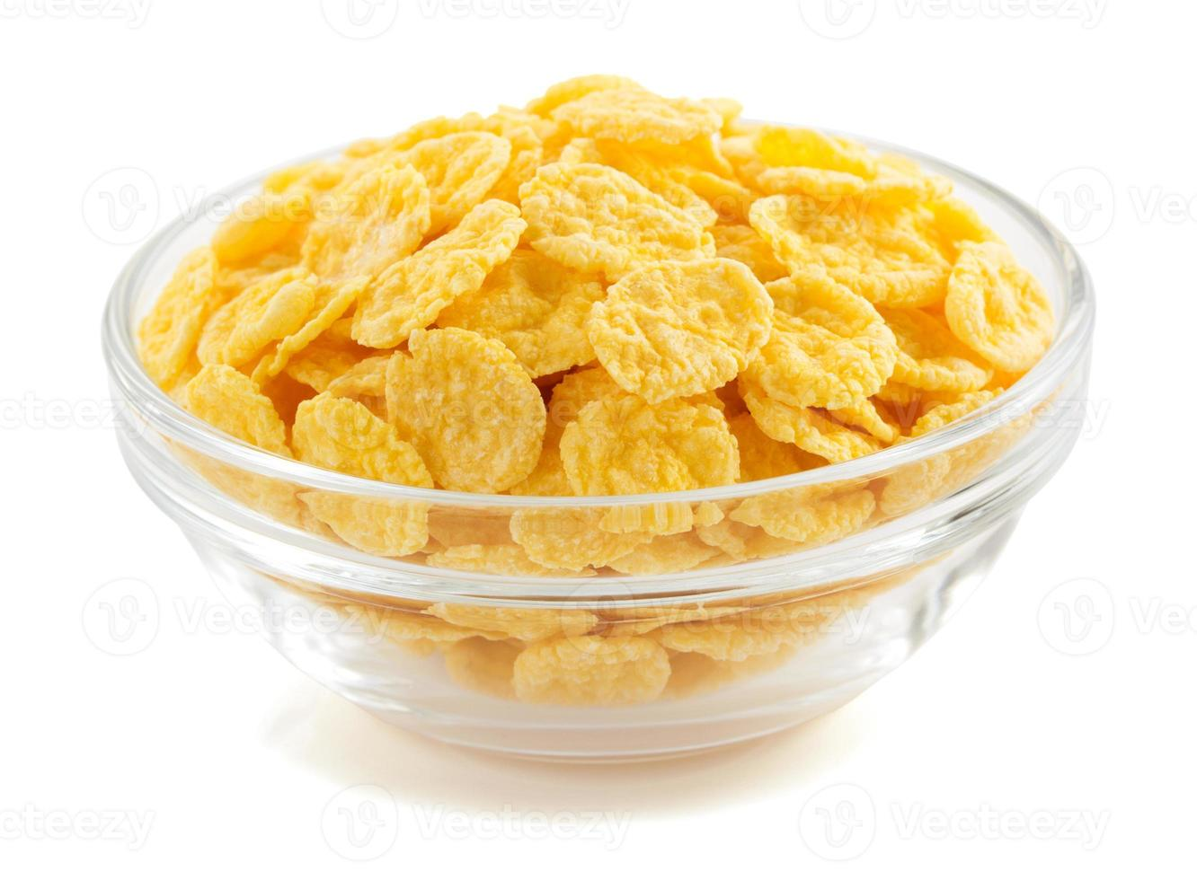 corn flakes in bowl on white photo