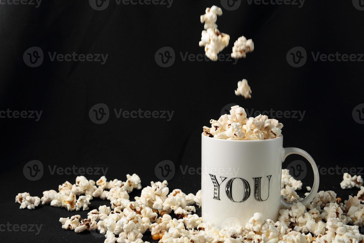 White jar with popcorn photo