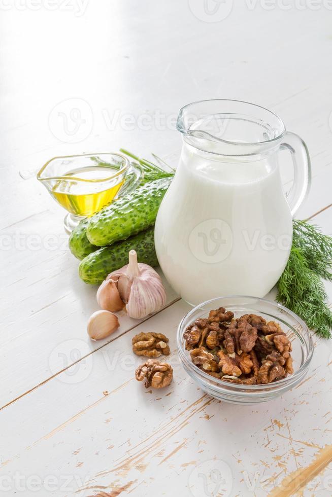 Tarator soup ingredients - cucumber, dill, walnuts, garlic, yogurt, oil photo