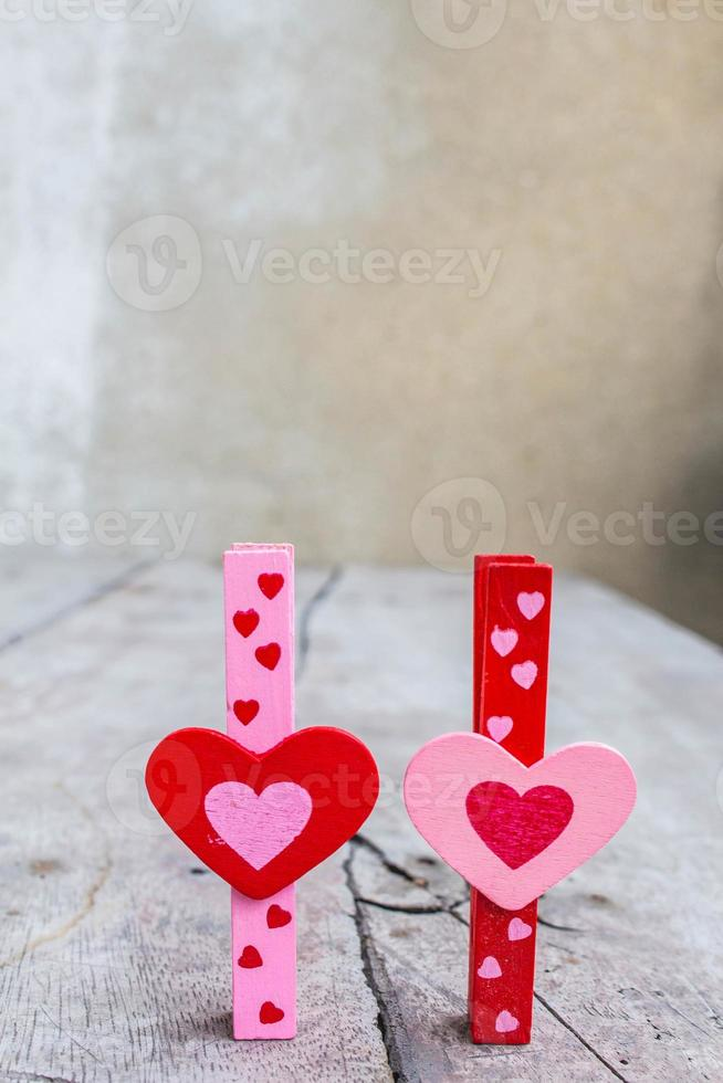 Colorful hearts on wooden photo
