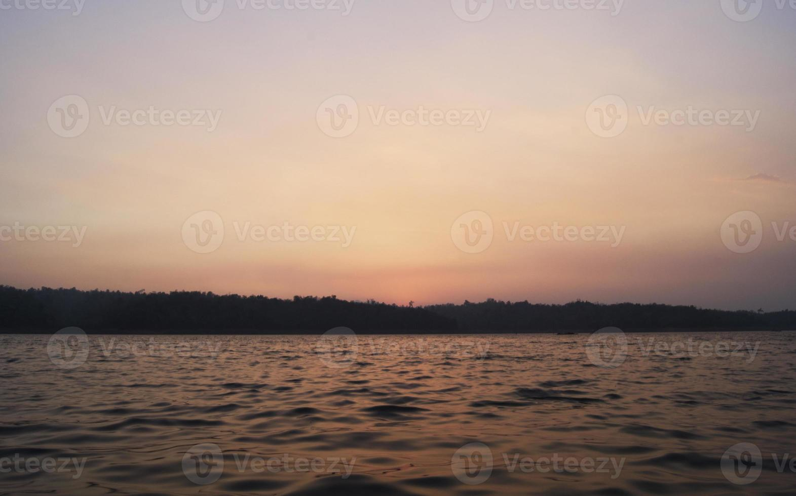 sunset in river photo