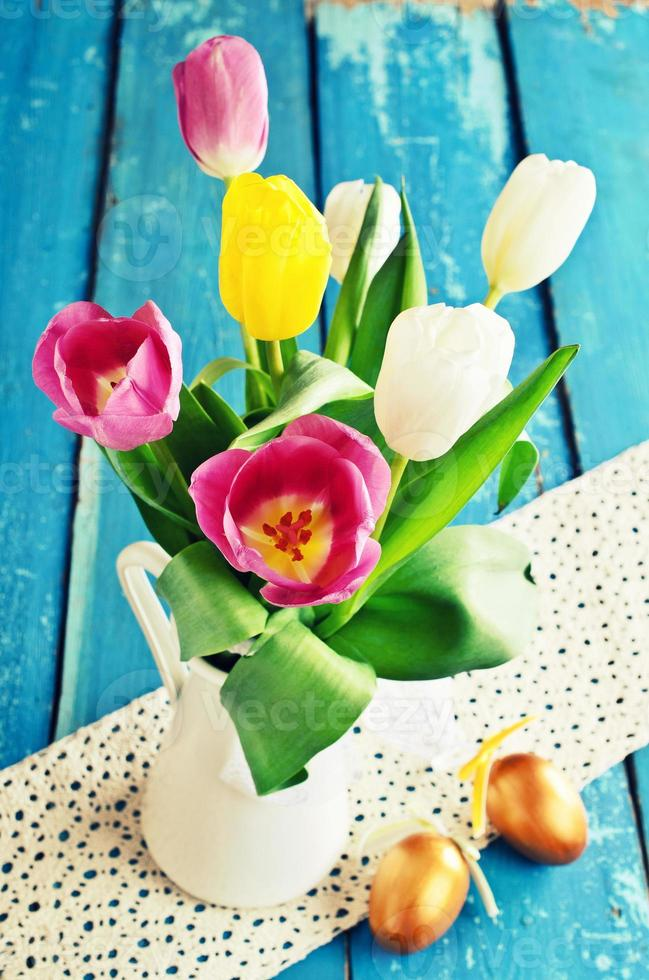 Tulips of different colors in the vase photo