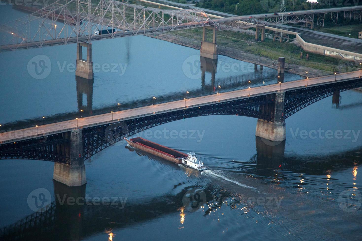 Barge carrying grain in Mississippi River photo