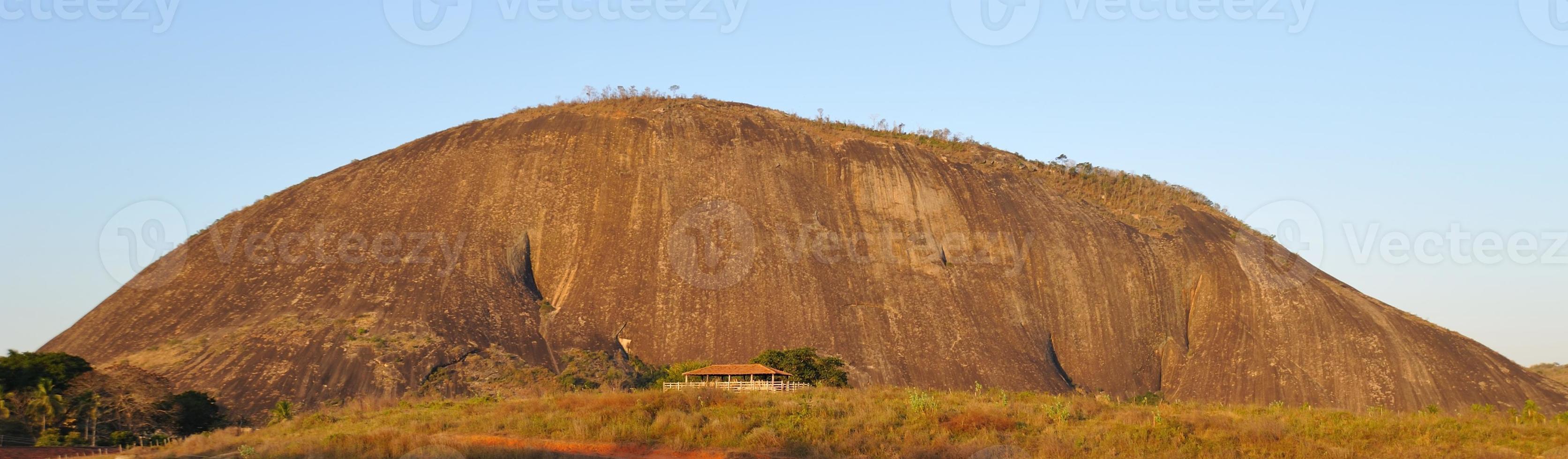 Rock at river Rio Doce in Brazil photo