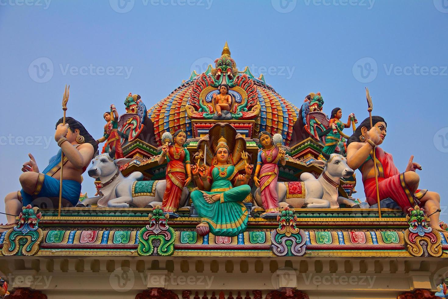 Hindu gods on a temple roof photo