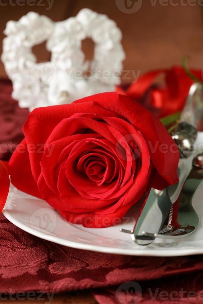romantic table setting with roses for the holiday St. Valentine photo