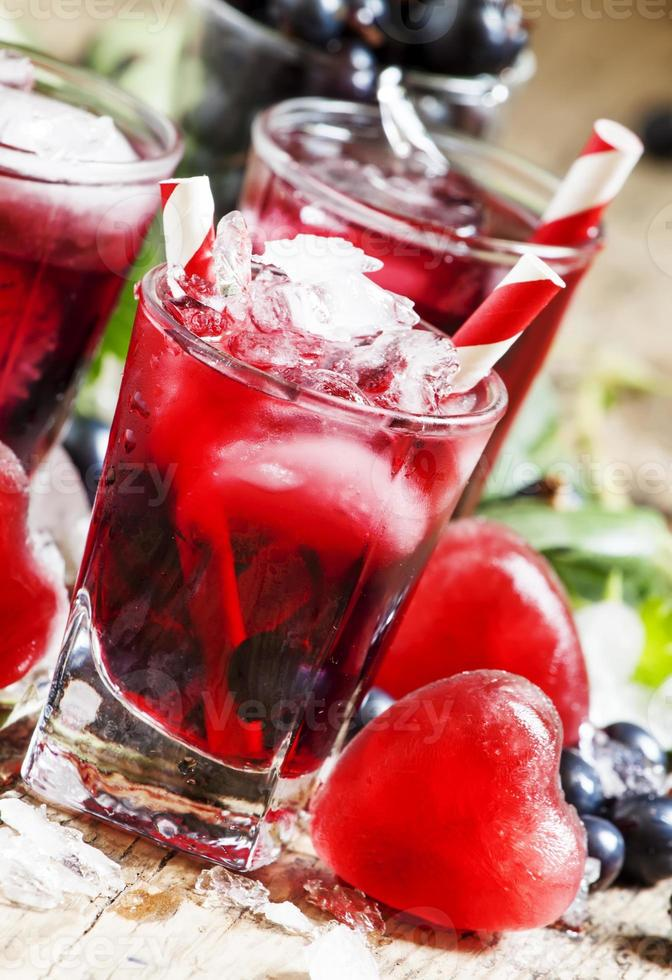 Red cold cocktail with berries photo