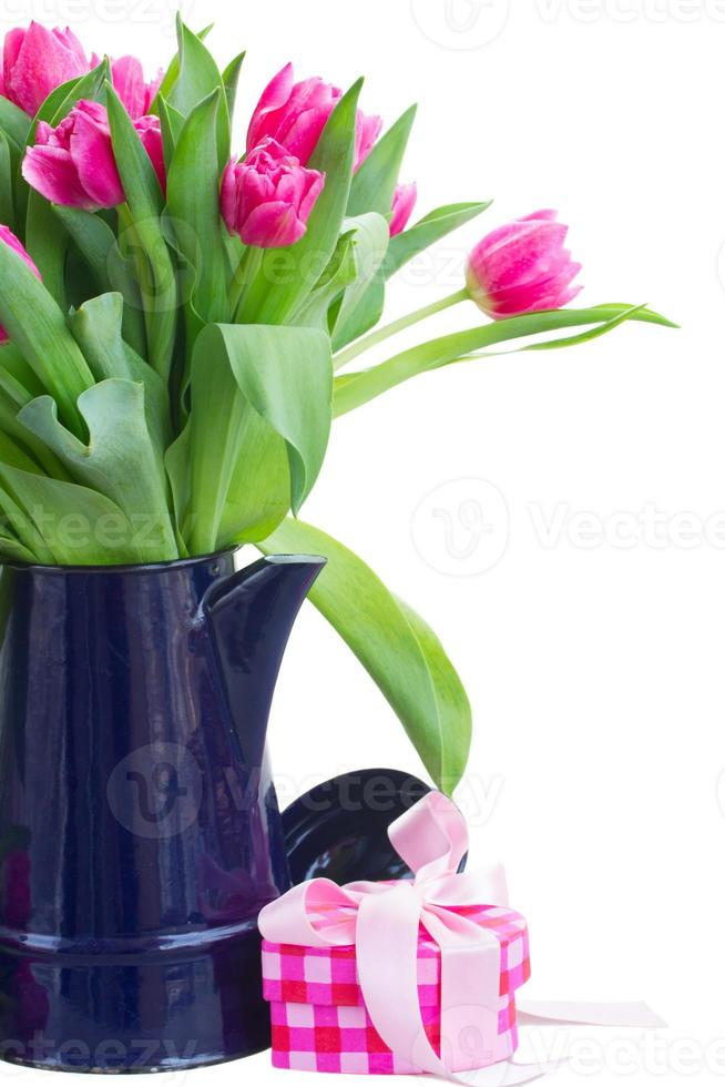 bouquet of multicolored   tulip flowers in white pot photo