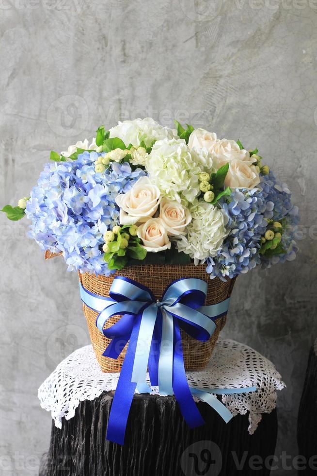 Beautiful flowers in basket photo