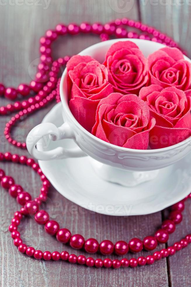 Pink roses in a cup photo