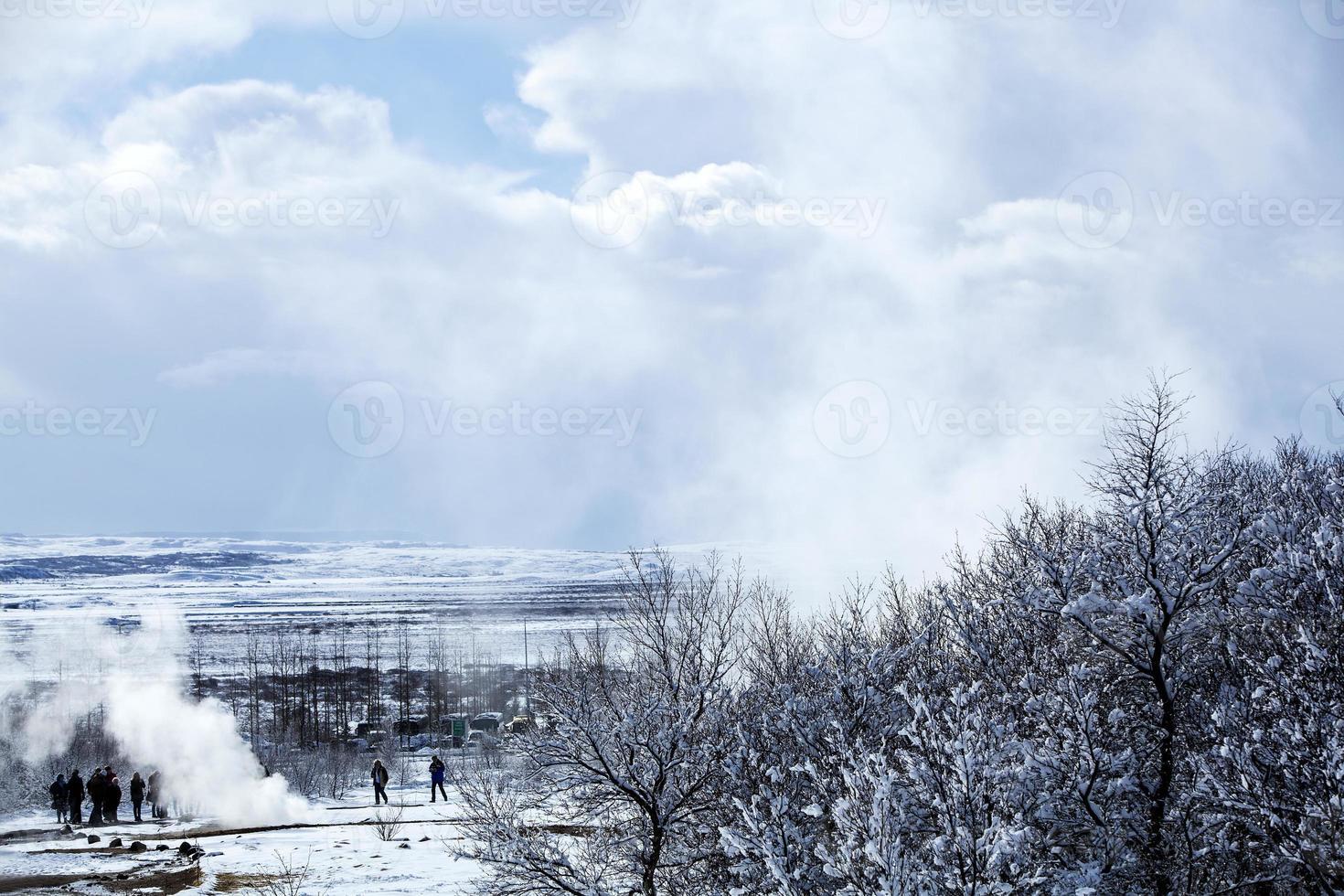 Geyser landscape in winter in Iceland photo